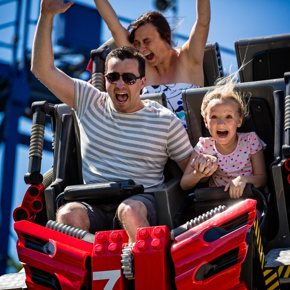 Dad and daughter in roller coaster